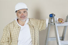 Portrait of a happy male contractor over colored background Royalty Free Stock Photo