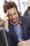 Portrait of happy male dispatcher working. In office, smiling royalty free stock photo
