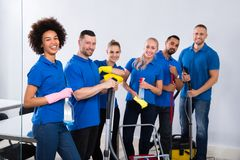 Portrait Of Happy Male And Female Janitors stock images