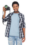 Portrait of a happy male photographer Stock Photos