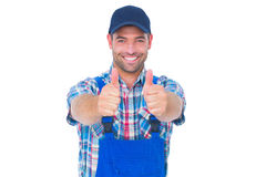 Portrait of happy male repairman gesturing thumbs up. On white background Stock Photography