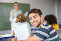 Portrait of happy male student. Sitting in the class Royalty Free Stock Photos