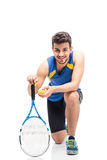 Portrait of a happy male tennis player. Isolated on a white background. Looking at camera Stock Photos