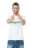 Portrait of a happy male volunteer gesturing thumbs up Royalty Free Stock Photography