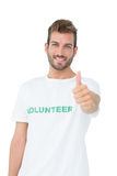 Portrait of a happy male volunteer gesturing thumbs up. Over white background Stock Image