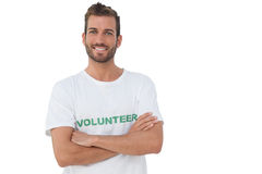 Portrait of a happy male volunteer with hands crossed Royalty Free Stock Image