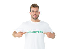 Portrait of a happy male volunteer pointing to himself Royalty Free Stock Images