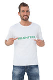 Portrait of a happy male volunteer pointing to himself Stock Photo