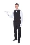 Portrait Of Happy Male Waiter. Holding Empty Tray Royalty Free Stock Photography