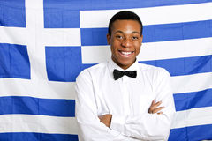 Portrait of happy man with arms crossed against Greek flag Royalty Free Stock Photos