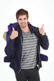 Portrait of happy man with backpack showing thumbs up Stock Photography