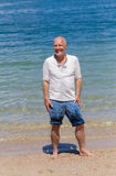 Portrait of happy man on the beach Stock Photography