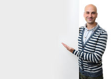 Portrait of happy man with blank advertising board Royalty Free Stock Photography