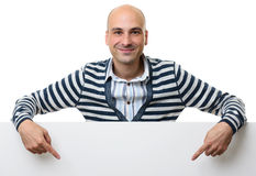 Portrait of happy man with blank advertising board Stock Photo