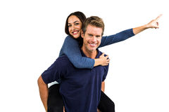 Portrait of happy man carrying girlfriend Royalty Free Stock Images