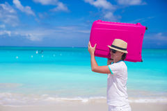 Portrait of happy man carrying his luggage on summer vacation Stock Photo