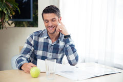 Portrait of a happy man checking bills Royalty Free Stock Images