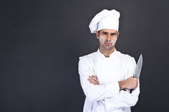 Portrait of happy man in cook uniform looking at camera Stock Images