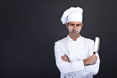 Portrait of happy man in cook uniform looking at camera Royalty Free Stock Photos