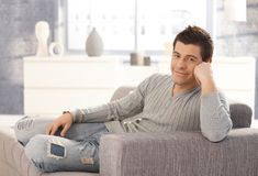 Portrait of happy man on couch Royalty Free Stock Photos