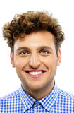 Portrait of a happy man with curly hair. On a white background Royalty Free Stock Images