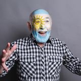 Senior man with Argentina flag painted on his face. Portrait of happy man with the flag of Argentina painted on his face. Football or soccer team fan, sport Royalty Free Stock Image