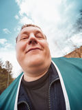 Portrait of the happy man. Fun portrait of the happy thick man on outdoors Royalty Free Stock Photo