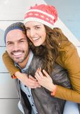 Portrait of happy man giving piggy back to woman Royalty Free Stock Photography