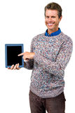 Portrait of happy man holding digital tablet Royalty Free Stock Image