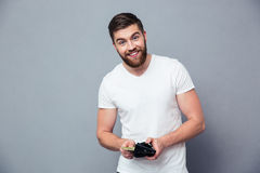 Portrait of a happy man holding wallet with money Stock Photos