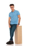 Portrait of happy man with legs crossed Stock Images