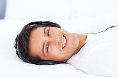 Portrait of a happy man listening music Stock Photos