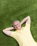 Portrait Of Happy Man Lying On Grass Royalty Free Stock Images