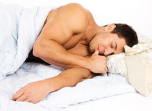 Portrait of a happy man  lying on his bed at home Stock Photo