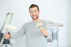 Portrait happy man painting new house. Portrait of happy man painting his new house Stock Images