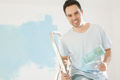 Portrait of happy man painting his new house Stock Image