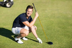 Portrait of happy man placing golf ball on tee Royalty Free Stock Photo