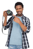 Portrait of a happy man pointing at his camera Stock Images