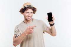 Portrait of a happy man presenting smartphone with blank screen Royalty Free Stock Photos