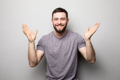 Portrait of happy man rise up hands and successful achievement of goals on grey. Portrait of happy man rise up hands and successful achievement of goals Stock Photography