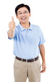 Portrait of happy man showing thumbs up while standing Royalty Free Stock Image