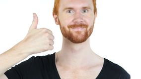 Portrait of happy man showing thumbs up while standing against white background Royalty Free Stock Images