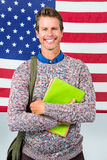 Portrait of happy man standing against American flag Stock Image