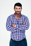 Portrait of a happy man standing with arms folded. Isolated on a white background Stock Images