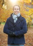 Portrait of a happy man standing outside on a fall day. Close up portrait of a happy man standing outside on a fall day royalty free stock photography