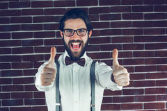 Portrait of happy man with thumbs up gesture Royalty Free Stock Photography
