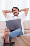 Portrait of a happy man using a laptop Royalty Free Stock Image