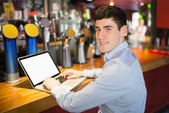 Portrait of happy man using laptop Stock Photo