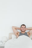 Portrait of a happy man waking up. In his bedroom Royalty Free Stock Photos
