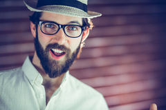 Portrait of happy man wearing hat and eyeglasses Royalty Free Stock Images